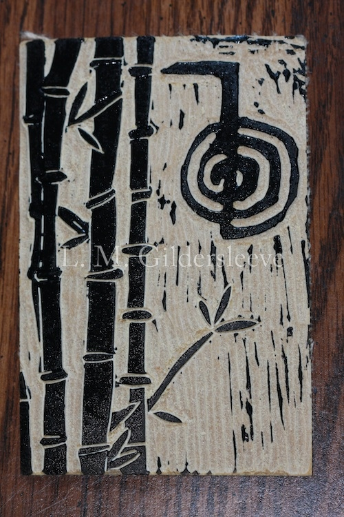 Linoleum block with Reiki symbol carving