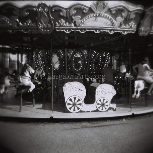 photograph of an amusement park carousel