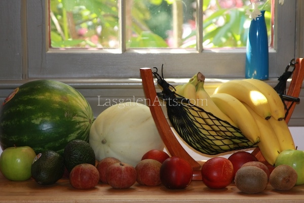 A photograph of fruit on a window sill.