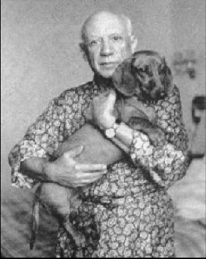 Photograph of Picasso holding a dachshund