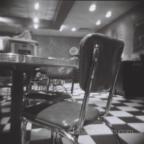 A photo of the inside of a diner.