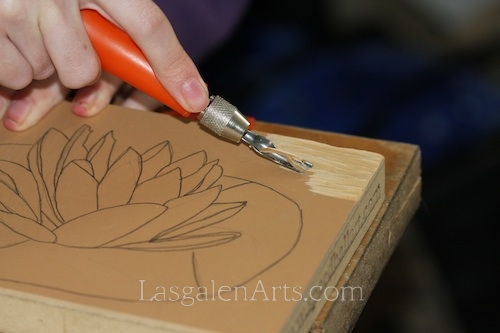Cutting a linoleum block for a water lily