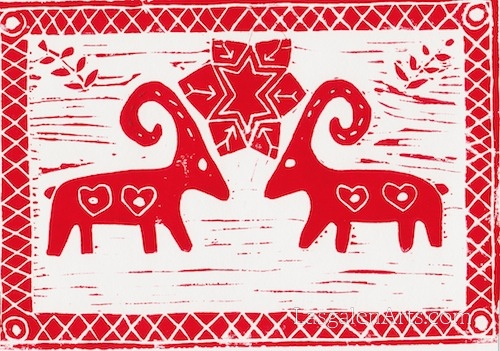 Linoleum block print of two Swedish Yule Goats, snowflake and leaves..