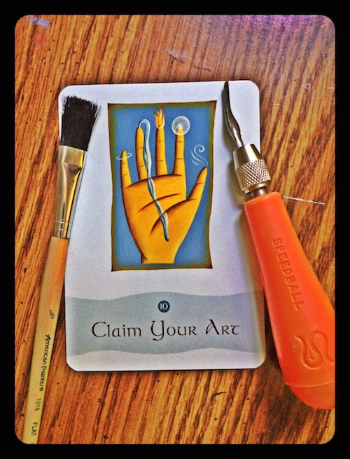 Card with a hand and the words claim your art.