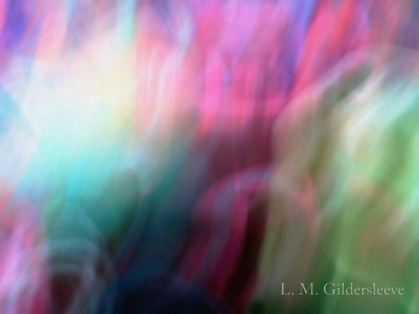 A photograph of bold blurring colors of teal, pink and lime green.